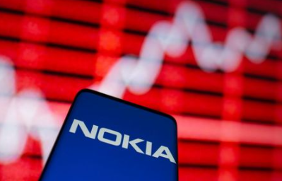 The Nokia logo is seen on a smartphone in front of a displayed stock graph in this illustration taken February 5, 2021. REUTERS/Dado Ruvic/Illustration