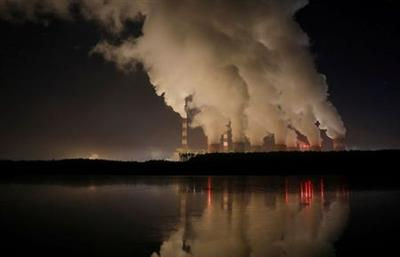 FILE PHOTO: Smoke and steam billows from Belchatow Power Station, Europe's largest coal-fired power plant operated by PGE Group, at night near Belchatow, Poland December 5, 2018. Picture taken December 5, 2018. REUTERS/Kacper Pempel/File Photo