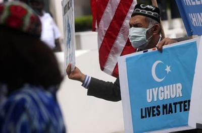 Setiwaldi Abdukadir takes part in a protest in front of the U.S. State Department to commemorate Uyghur Doppa Day and to urge the U.S. and the international community to take action against China's treatment of the Uyghur people in the East Turkestan (Xinjiang) region, in Washington, U.S. May 5, 2021. REUTERS/Leah Millis