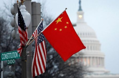 FILE PHOTO: The People's Republic of China flag and the U.S. flag fly on a lamp post along Pennsylvania Avenue near the U.S. Capitol in Washington during then-Chinese President Hu Jintao's state visit, January 18, 2011. REUTERS/Hyungwon Kang/File Photo