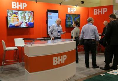 Visitors to the BHP (formerly known as BHP Billiton) booth speak with representatives during the Prospectors and Developers Association of Canada (PDAC) annual convention in Toronto, Ontario, Canada March 4, 2019. REUTERS/Chris Helgren