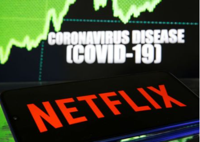 Netflix logo is seen in front of diplayed coronavirus disease (COVID-19) in this illustration taken March 19, 2020. REUTERS/Dado Ruvic/Illustration