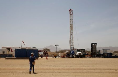 FILE PHOTO: A worker walks at a Tullow Oil explorational drilling site in Lokichar, Turkana County, Kenya, February 8, 2018. REUTERS/Baz Ratner/File Photo