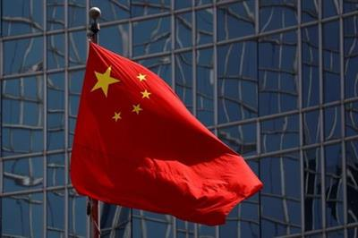 FILE PHOTO: The Chinese national flag is seen in Beijing, China April 29, 2020. REUTERS/Thomas Peter