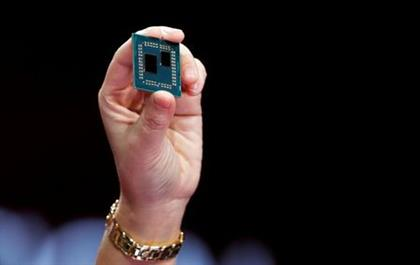 FILE PHOTO: Lisa Su, president and CEO of AMD, holds up a 3rd generation Ryzen desktop processor during a keynote address at the 2019 CES in Las Vegas, Nevada, U.S., January 9, 2019. REUTERS/Steve Marcus/File Photo