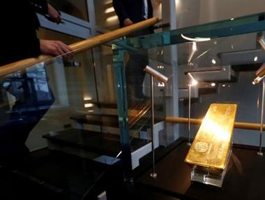 FILE PHOTO: A pure gold bar is seen in the ABLV bank head office in Riga, Latvia March 7, 2018. Picture taken March 7, 2018. REUTERS/Ints Kalnins/File photo