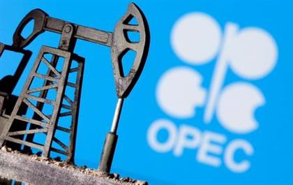 FILE PHOTO: A 3D-printed oil pump jack is seen in front of displayed OPEC logo in this illustration picture, April 14, 2020. REUTERS/Dado Ruvic/File Photo