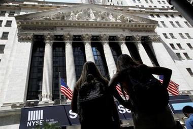 Members of a tour group look at the front facade of the New York Stock Exchange (NYSE) in New York City, U.S., June 21, 2021. REUTERS/Brendan McDermid