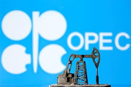 FILE PHOTO: A 3D printed oil pump jack is seen in front of displayed Opec logo in this illustration picture, April 14, 2020. REUTERS/Dado Ruvic