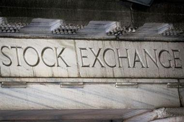 """""""Stock Exchange"""" is seen over an entrance to the New York Stock Exchange (NYSE) on Wall St. in New York City, U.S., March 29, 2021. REUTERS/Brendan McDermid"""