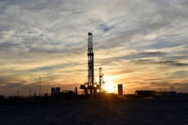 FILE PHOTO: Drilling rigs operate at sunset in Midland, Texas, U.S., February 13, 2019. Picture taken February 13, 2019. REUTERS/Nick Oxford/File Photo