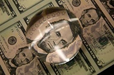 FILE PHOTO: Sheets of former U.S. President Abraham Lincoln on the five-dollar bill currency are seen through a magnifying glass at the Bureau of Engraving and Printing in Washington March 26, 2015. REUTERS/Gary Cameron/File Photo