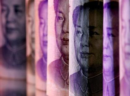 FILE PHOTO: Chinese Yuan banknotes are seen in this illustration taken February 10, 2020. REUTERS/Dado Ruvic/Illustration/File Photo