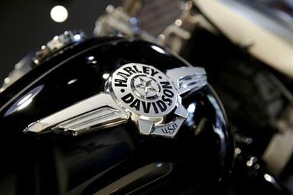 FILE PHOTO: The logo of U.S. motorcycle company Harley-Davidson is seen on one of their models at a shop in Paris, France, August 16, 2018. REUTERS/Philippe Wojazer