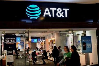 Shoppers walk past an AT&T store at the King of Prussia Mall in King of Prussia, Pennsylvania, U.S. November 22, 2019. REUTERS/Mark Makela