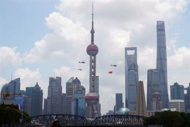 Aircraft fly in formation past Oriental Pearl Tower at Lujiazui financial district of Pudong on the 100th founding anniversary of the Communist Party of China, in Shanghai, China July 1, 2021. REUTERS/Aly Song