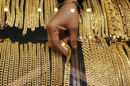 A vendor arranges gold chains displayed at VJ Gold and Diamond jewellery shop in Kuala Lumpur, Malaysia August 10, 2020. REUTERS/Lim Huey Teng