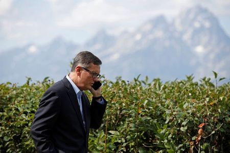 """Federal Reserve Vice Chair Richard Clarida talks on the phone during the three-day """"Challenges for Monetary Policy"""" conference in Jackson Hole, Wyoming, U.S., August 23, 2019. REUTERS/Jonathan Crosby"""