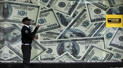 FILE PHOTO: A security guard walks past a montage of old U.S. dollar bills outside a currency exchange in Kenya's capital Nairobi July 23, 2015. REUTERS/Thomas Mukoya/File Photo