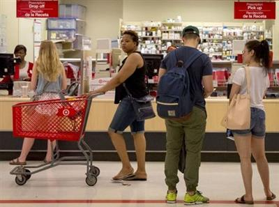 Customers shop in the pharmacy department of a Target store in the Brooklyn borough of New York June 15, 2015. Drugstore operator CVS Health Corp said it will acquire Target Corp's U.S. pharmacy and clinics businesses for about $1.9 billion to boost sales and prescription volumes. REUTERS/Brendan McDermid