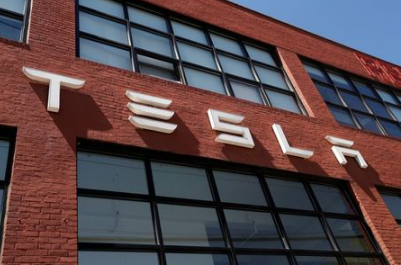 FILE PHOTO: The TESLA logo is seen outside a dealership in the Brooklyn borough of New York City, U.S., April 26, 2021. REUTERS/Shannon Stapleton