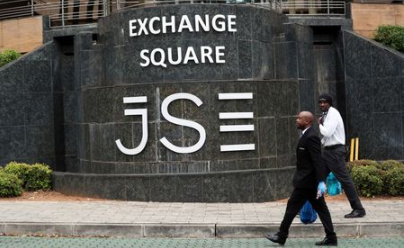 Security officers walk past the Johannesburg Stock Exchange (JSE) in Sandton, South Africa, March 30, 2020. REUTERS/Siphiwe Sibeko