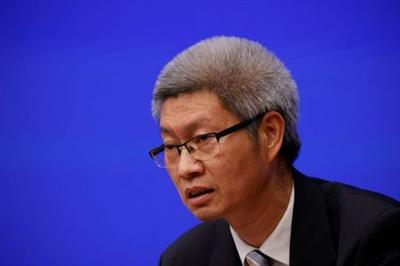 Chen Xu, an official at the State Administration for Market Regulation, attends a news conference about measures to prevent and control a winter outbreak of COVID-19 in Beijing, China November 12, 2020. REUTERS/Thomas Peter