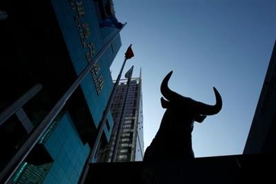 A sculpture of a bull is seen outside the Shenzhen Stock Exchange at the southern Chinese city of Shenzhen in Guangdong province November 25, 2008. REUTERS/Bobby Yip/Files