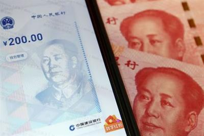 FILE PHOTO: China's official app for digital yuan is seen on a mobile phone next to 100-yuan banknotes in this illustration picture taken October 16, 2020. REUTERS/Florence Lo/Illustration/File Photo