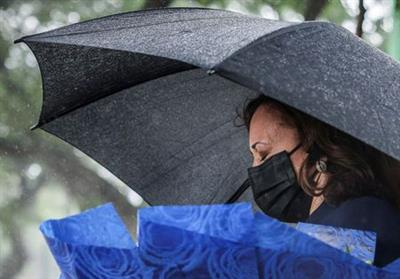 U.S. Vice President Kamala Harris lays flowers at the Senator John McCain's memorial site, where his Navy aircraft was shot down by the North Vietnamese, on the three-year anniversary of his death, in Hanoi, Vietnam, August, 25, 2021. REUTERS/Evelyn Hockstein/Pool TPX IMAGES OF THE DAY