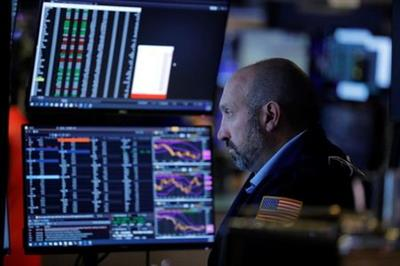 A trader works on the floor at the New York Stock Exchange (NYSE) in Manhattan, New York City, U.S., August 20, 2021. REUTERS/Andrew Kelly