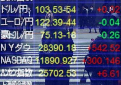 Passersby wearing protective face masks are reflected on screen displaying the Japanese yen exchange rate against the U.S. dollar, other foreign currecies and world stock indexes outside a brokerage, amid the coronavirus disease (COVID-19) outbreak, in Tokyo, Japan November 6, 2020. REUTERS/Issei Kato