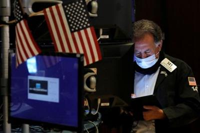 A trader works on the floor at the New York Stock Exchange (NYSE) in Manhattan, New York City, U.S., August 4, 2021. REUTERS/Andrew Kelly