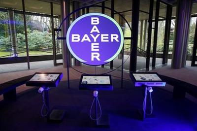 FILE PHOTO: The logo of Bayer AG is seen in a showroom of the German drugmaker where the annual results news conference takes place in Leverkusen, Germany February 27, 2020. REUTERS/Wolfgang Rattay/File Photo
