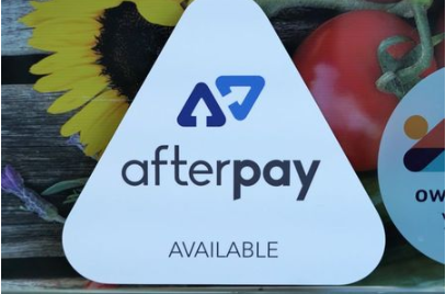 A logo for the company Afterpay is seen in a store window in Sydney, Australia, July 9, 2020. REUTERS/Stephen Coates