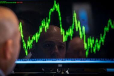 FILE PHOTO: A Specialist trader watches his chart while working on the floor of the New York Stock Exchange July 8, 2014. REUTERS/Brendan McDermid/File Photo