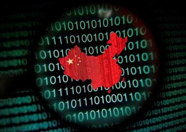 FILE PHOTO: A map of China is seen through a magnifying glass on a computer screen showing binary digits in Singapore in this January 2, 2014 photo illustration. Picture taken January 2, 2014. REUTERS/Edgar Su/File Photo