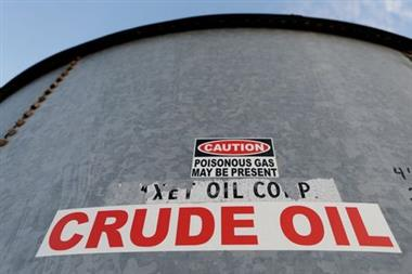 FILE PHOTO: A sticker reads crude oil on the side of a storage tank in the Permian Basin in Mentone, Loving County, Texas, U.S. November 22, 2019. REUTERS/Angus Mordant/File Photo