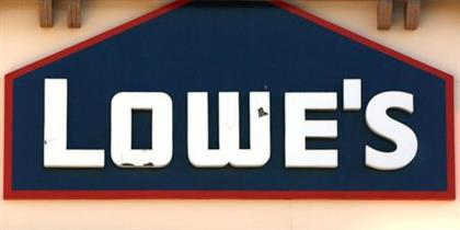 The sign outside the Lowe's store is seen in Westminster, Colorado February 26, 2014. Lowe's rose 5.3 percent to $50.69 after the home improvement retailer reported earnings and sales growth and an additional stock buyback program of $5 billion. REUTERS/Rick Wilking (UNITED STATES - Tags: BUSINESS)