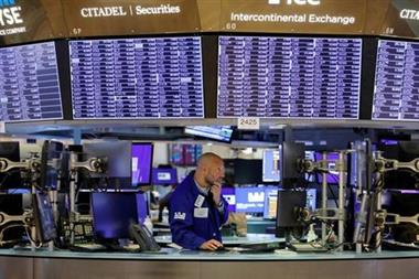 FILE PHOTO: A trader works on the trading floor at the New York Stock Exchange (NYSE) in Manhattan, New York City, U.S., August 9, 2021. REUTERS/Andrew Kelly/File Photo