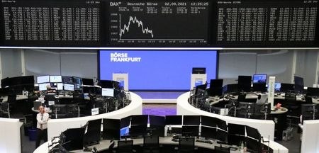 FILE PHOTO: The German share price index DAX graph is pictured at the stock exchange in Frankfurt, Germany, September 2, 2021. REUTERS/Staff