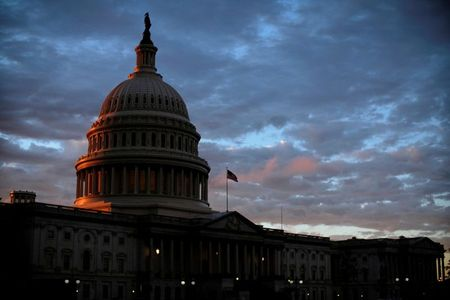 FILE PHOTO: The sun sets behind the U.S. Capitol dome in Washington, U.S., on midterm election day, November 6, 2018. REUTERS/James Lawler Duggan/File Photo