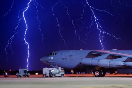 FILE PHOTO: Lightning strikes behind a B-52H Stratofortress at Minot Air Force Base, North Dakota, U.S. on August 8, 2017. Courtesy J.T. Armstrong/U.S. Air Force photo/Handout via REUTERS ATTENTION EDITORS - THIS IMAGE HAS BEEN SUPPLIED BY A THIRD PARTY./File Photo