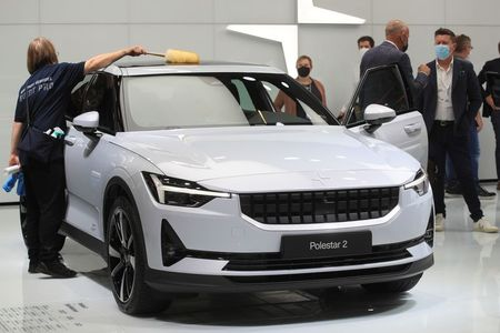 A person cleans a Polestar 2 during Munich Auto Show, IAA Mobility 2021 in Munich, Germany, September 8, 2021. REUTERS/Wolfgang Rattay