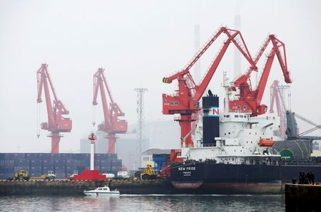 FILE PHOTO: A crude oil tanker is seen at Qingdao Port, Shandong province, China, April 21, 2019. REUTERS/Jason Lee/File Photo