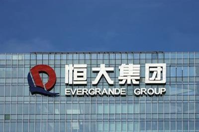 The company logo is seen on the headquarters of China Evergrande Group in Shenzhen, Guangdong province, China September 26, 2021. REUTERS/Aly Song