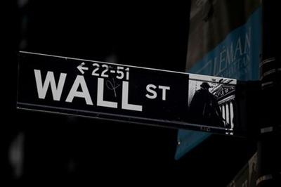 FILE PHOTO: A Wall St. street sign is seen near the New York Stock Exchange (NYSE) in New York City, U.S., September 17, 2019. REUTERS/Brendan McDermid//File Photo