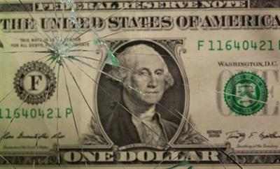 One U.S. dollar banknote is pictured through broken glass in this illustration taken June 25, 2021. REUTERS/Dado Ruvic/Illustration