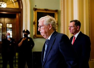 U.S. Senate Republican Leader Mitch McConnell (R-KY) is followed by Senator John Barrasso (R-WY) prior to the Senate Republicans weekly policy lunch at the U.S. Capitol in Washington, U.S., September 28, 2021. REUTERS/Elizabeth Frantz