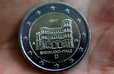 FILE PHOTO: A newly designed 2-Euro coin is pictured during a presentation at the Chancellery in Berlin, Germany February 10, 2017. REUTERS/Hannibal Hanschke/File Photo